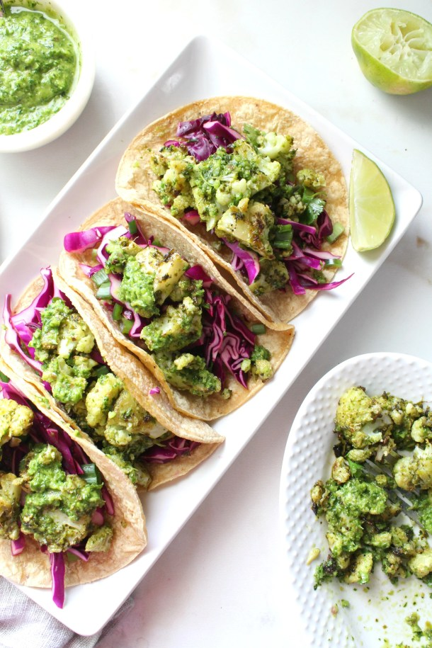 Crispy, roasted cauliflower is combined with bright, fresh chimichurri sauce in corn tortillas with a purple cabbage slaw in theseCrispy Chimichurri Cauliflower Tacos. So many great flavors in these vegan beauties | ThisSavoryVegan.com #vegantacos #tacotuesday #veganrecipe