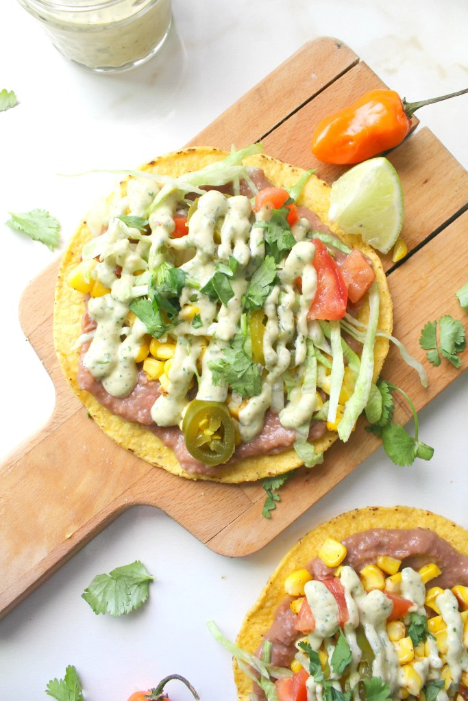 TheseRoasted Corn Tostadas with Vegan Habanero Cream Sauce are the perfect summer dinner - crunchy tortillas are topped with refried beans, charred corn and a habanero cream sauce | ThisSavoryVegan.com #thissavoryvegan #cincodemayo #summer #simpleveganrecipe