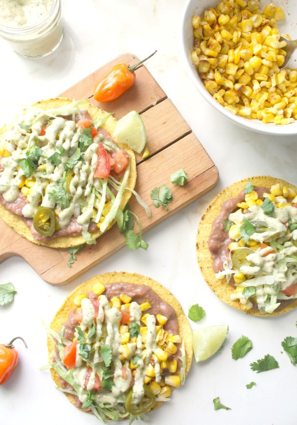 These Roasted Corn Tostadas with Vegan Habanero Cream Sauce are the perfect summer dinner - crunchy tortillas are topped with refried beans, charred corn and a habanero cream sauce | ThisSavoryVegan.com #thissavoryvegan #cincodemayo #summer #simpleveganrecipe