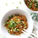 These Spicy Sriracha Noodles are the quickest and easiest vegan dinner. Made with rice noodles and a soy sauce & sriracha sauce that will have your lips tingling | ThisSavoryVegan.com #thissavoryvegan #easydinner #spicy #veganrecipe