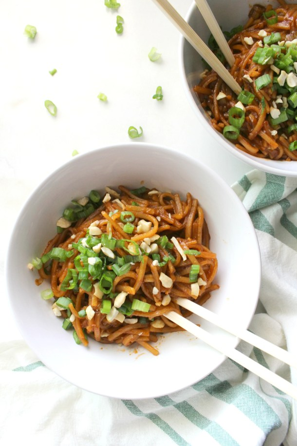 These Spicy Sriracha Noodles are the quickest and easiest vegan dinner. Made with rice noodles and a soy sauce & sriracha sauce that will have your lips tingling   ThisSavoryVegan.com #thissavoryvegan #easydinner #spicy #veganrecipe