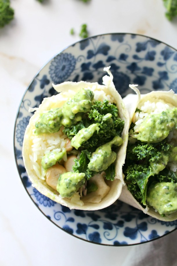 These White Bean, Rice & Kale Vegan Burritos are the perfect meal on the go. Packed full of marinated kale, hot white rice and beans mixed with Creamy Dreamy Green Sauce. Both healthy and delicious | ThisSavoryVegan.com #thissavoryvegan #veganburrito #vegan