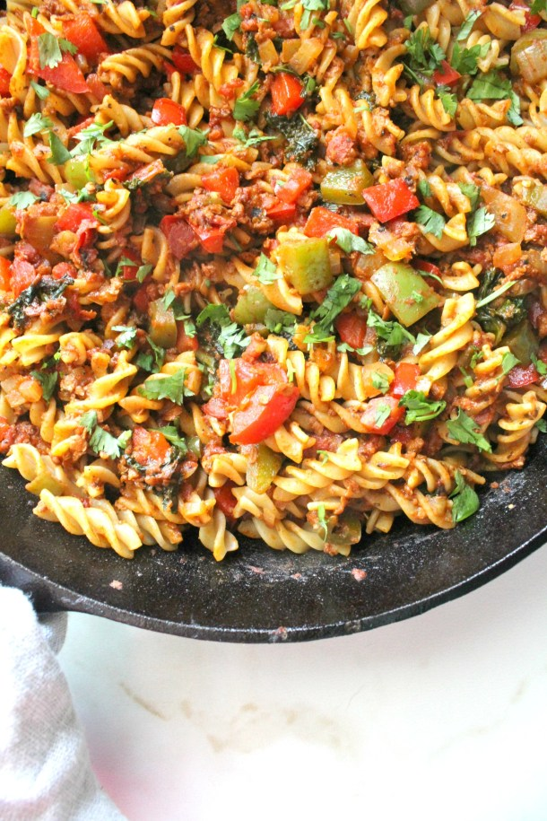 ThisVegan Soyrizo Pasta is packed full of chopped veggies, soyrizo and greens. The perfect weeknight dinner - ready in less than 30 minutes! | ThisSavoryVegan.com #thissavoryvegan #vegan #veganrecipe #quickdinner