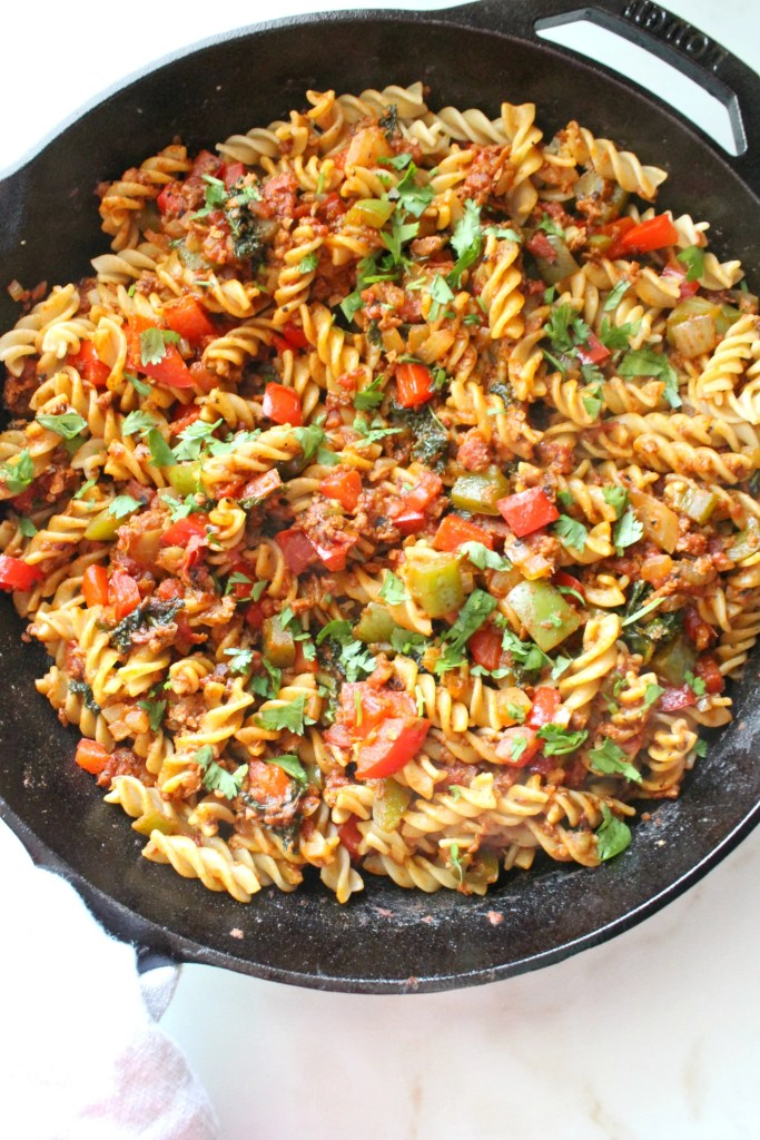 This Vegan Soyrizo Pasta is packed full of chopped veggies, soyrizo and greens. The perfect weeknight dinner - ready in less than 30 minutes! | ThisSavoryVegan.com #thissavoryvegan #vegan #veganrecipe #quickdinner