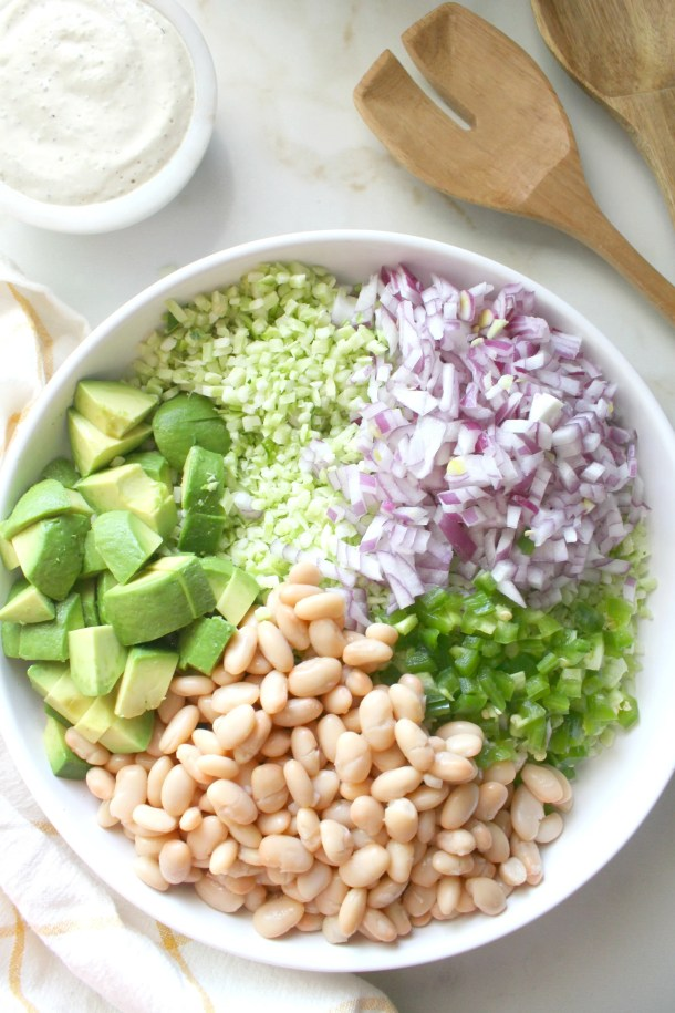 This delicious Broccoli Rice White Bean Summer Salad is a healthy combo of veggies and beans tossed in a creamy tahini dressing. Serve this in place of coleslaw at your next BBQ   ThisSavoryVegan.com #thissavoryvegan #summersalad #vegan