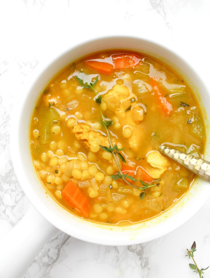 This Vegan Chicken Couscous Soup is healthy, comforting and perfect for cold season. Next time you're feeling sick or it is a cold winter night, make this soup to feel warm and toasty | ThisSavoryVegan.com #thissavoryvegan #vegansoup #coldbuster