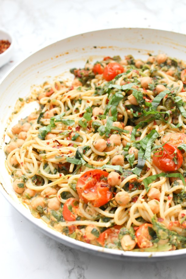 This Creamy Vegan Sun-Dried Tomato, Chickpea, Hummus Spaghetti is a simple dinner recipe that is filling, comforting and delicious   ThisSavoryVegan.com #thissavoryvegan #vegan #veganpasta