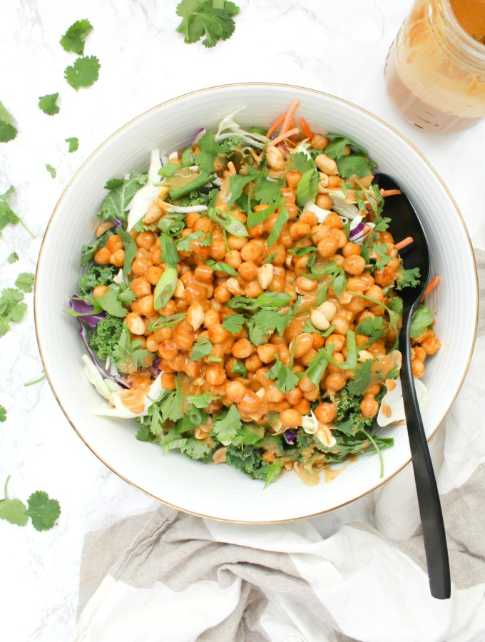 This Crunchy Chickpea Kale Salad with Peanut Ginger Dressing is a healthy dinner recipe that is both quick and tasty | ThisSavoryVegan.com #thissavoryvegan #vegansalad