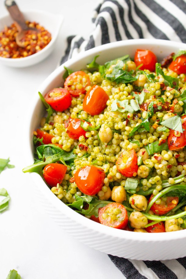 This Vegan Mediterranean Couscous Salad is packed full of pearl couscous, chickpeas, sun-dried tomatoes, cherry tomatoes, pesto and arugula | ThisSavoryVegan.com #thissavoryvegan #vegan #vegansalad