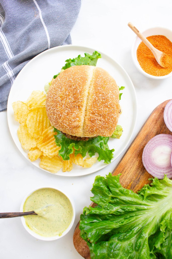 These Vegan Cajun Black Bean Burgers are loaded with a zesty patty, cajun aioli and an avocado salsa. The ultimate combo of flavors   ThisSavoryVegan.com #thissavoryvegan #veganburger #summereats