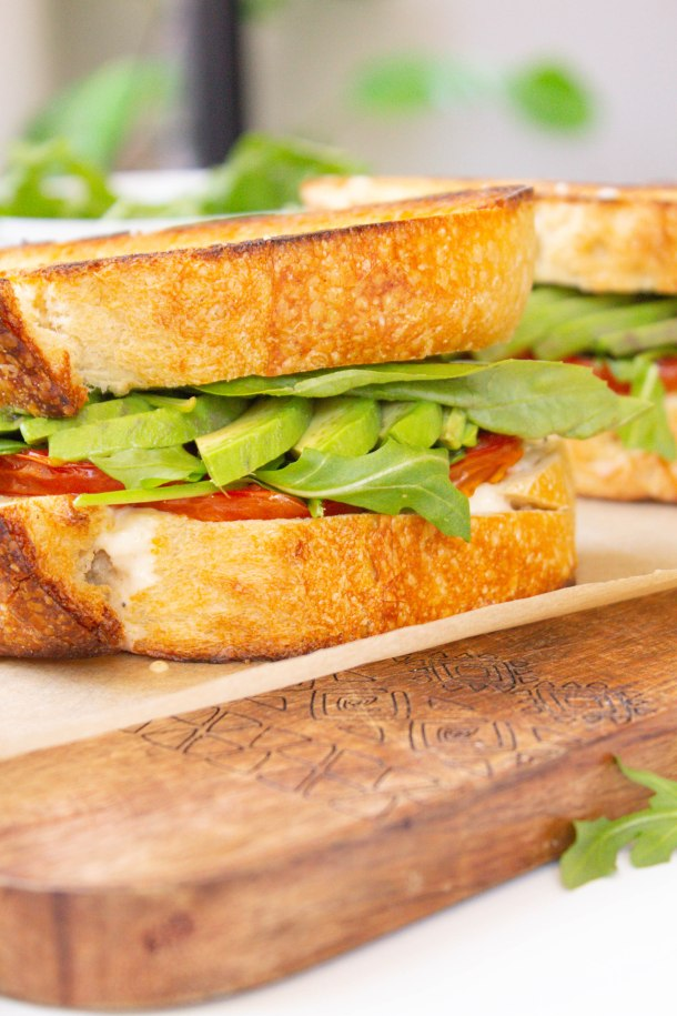 These Roasted Tomato Sandwiches with Vegan Lemon Garlic Aioli are loaded with avocado, arugula and some of the tastiest tomato slices   ThisSavoryVegan.com #thissavoryvegan #vegansandwiches #vegan