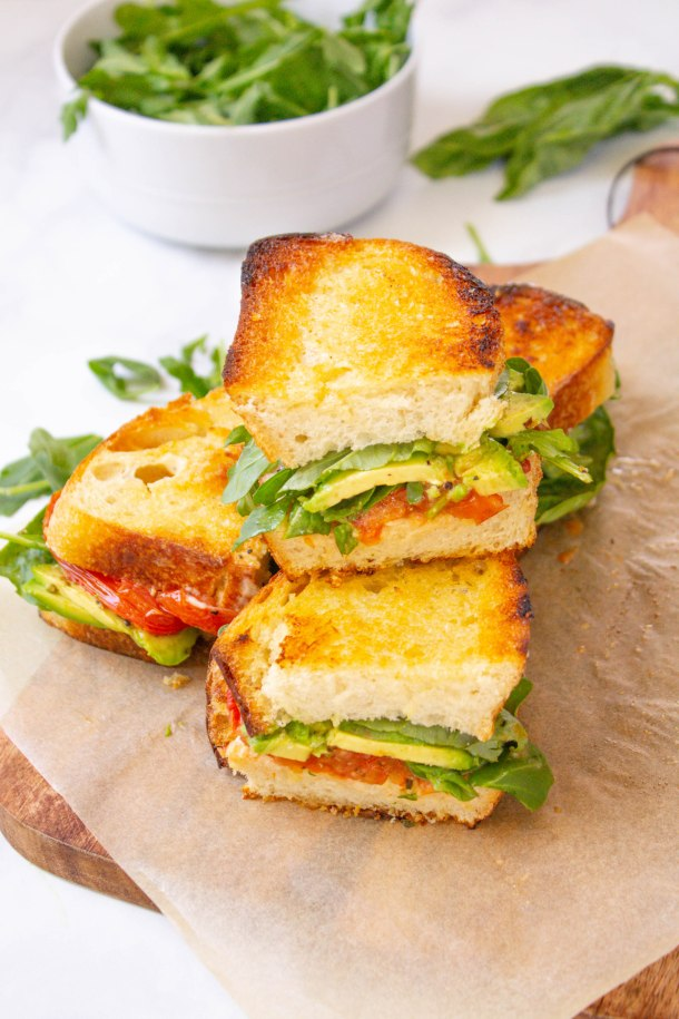 These Roasted Tomato Sandwiches with Vegan Lemon Garlic Aioli are loaded with avocado, arugula and some of the tastiest tomato slices | ThisSavoryVegan.com #thissavoryvegan #vegansandwiches #vegan