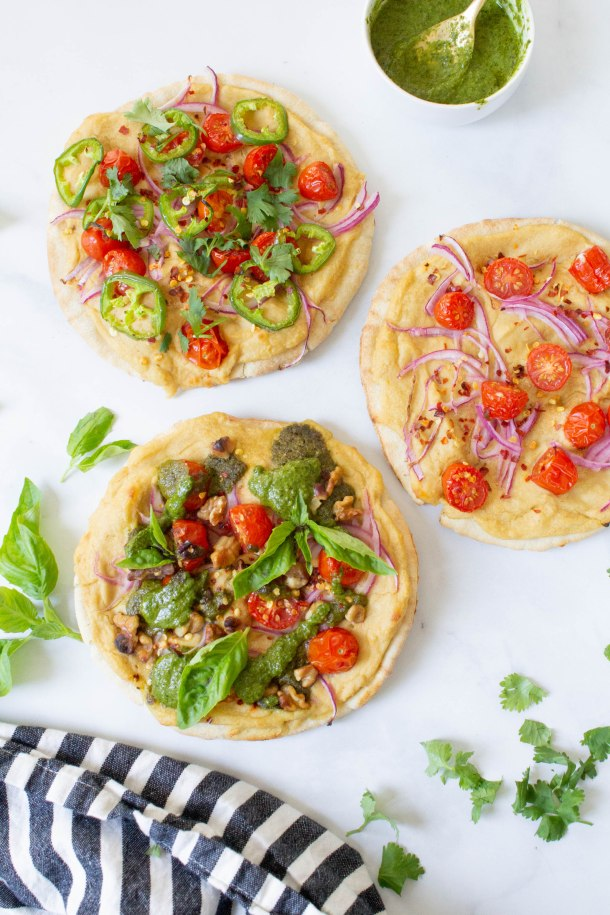 Hummus Pita Pizzas 3 Ways - making vegan pizza at home is super easy when you use hummus and pita bread as your base. Add your favorite toppings and bake | ThisSavoryVegan.com #thissavoryvegan #vegan #veganpizza