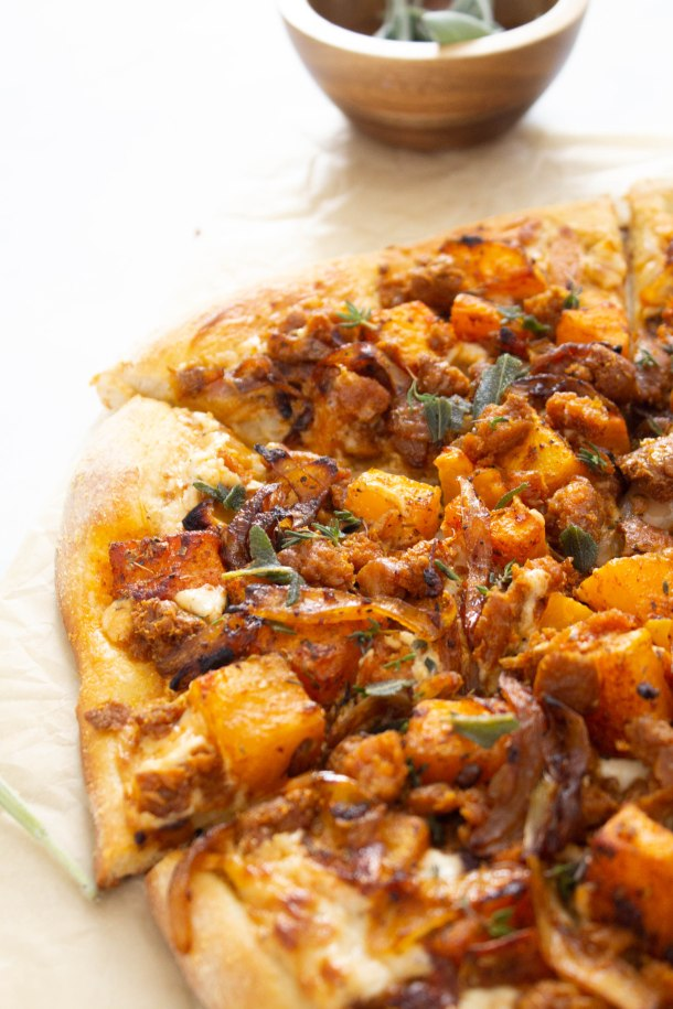 This Vegan Butternut Squash and Sausage Pizza is the ultimate Fall pizza recipe. Complete with a cream cheese sauce, caramelized onions & fried sage | ThisSavoryVegan.com #thissavoryvegan #veganpizza #veganfallrecipe