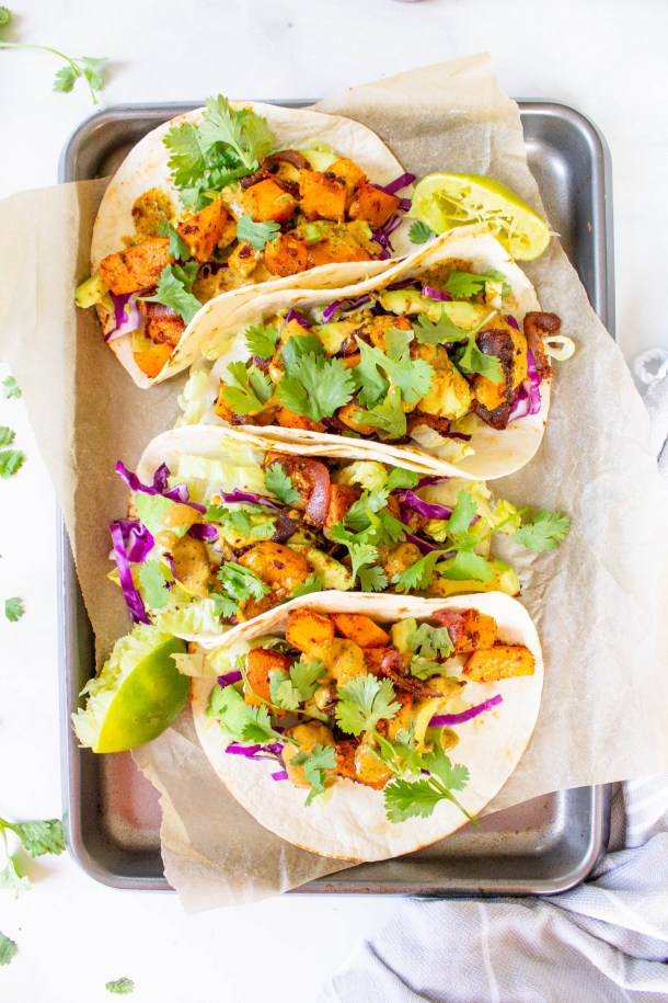 These Vegan Butternut Squash Tacos with Chipotle Cilantro Sauce are a healthy mix of roasted veggies, crunchy toppings and spicy sauce   ThisSavoryVegan.com #thissavoryvegan #vegantacos #tacotuesday