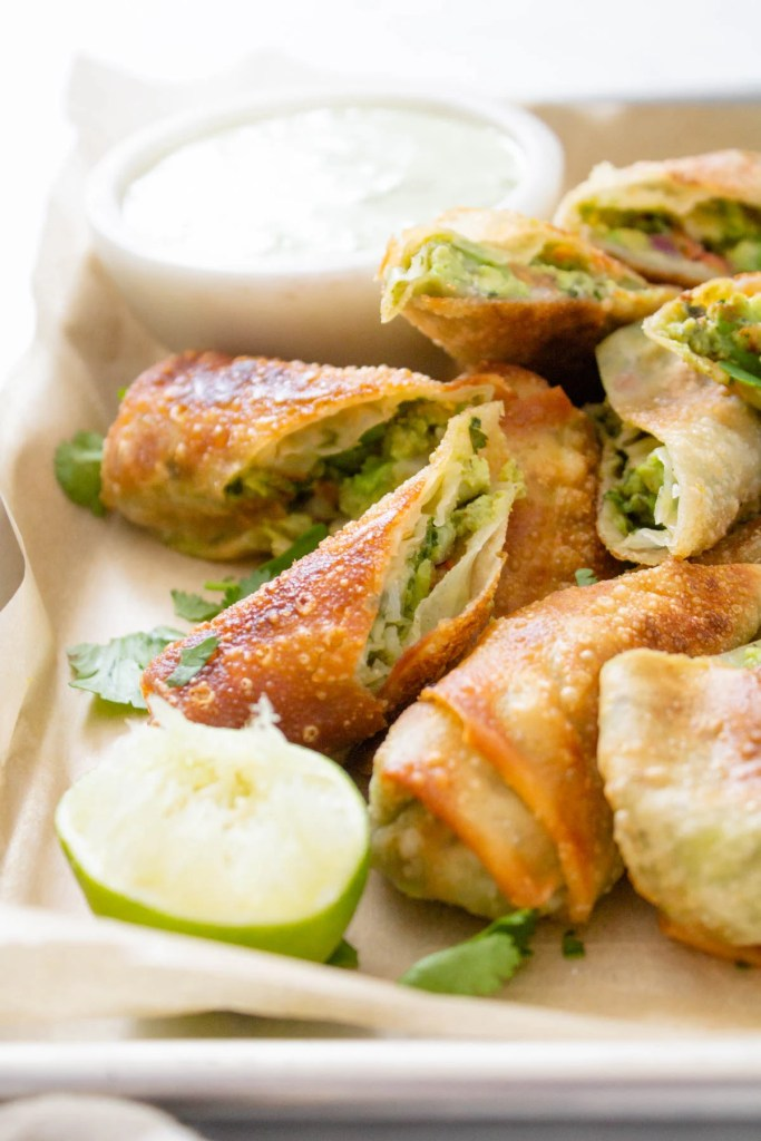 These Avocado Egg Rolls with Vegan Cilantro Ranch are the perfect party appetizer! Perfectly crispy, simple to make and totally tasty | ThisSavoryVegan.com #thissavoryvegan #vegan #eggrolls