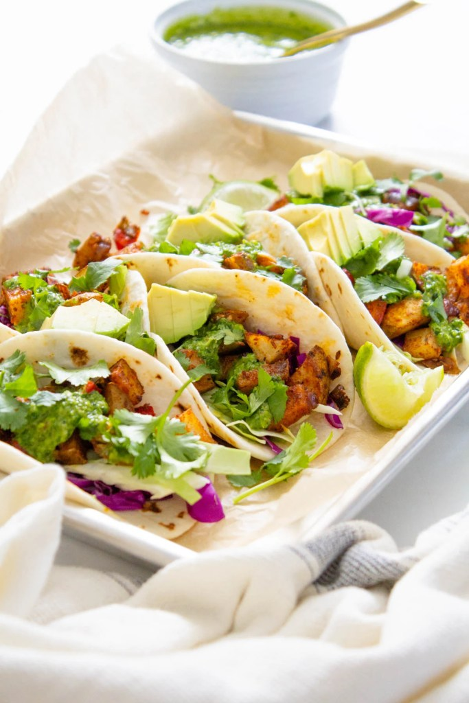 These Roasted Potato Tacos with Chimichurri are perfectly seasoned, bursting with flavor and the perfect at home vegan Taco Tuesday meal! | ThisSavoryVegan.com #thissavoryvegan #vegantacos