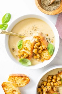 This Roasted Cauliflower Soup with Basil Chickpeas is the most comforting and delicious vegan meal. The chickpeas add the best crunch to this creamy soup | ThisSavoryVegan.com #thissavoryvegan #vegansoup #cauliflower