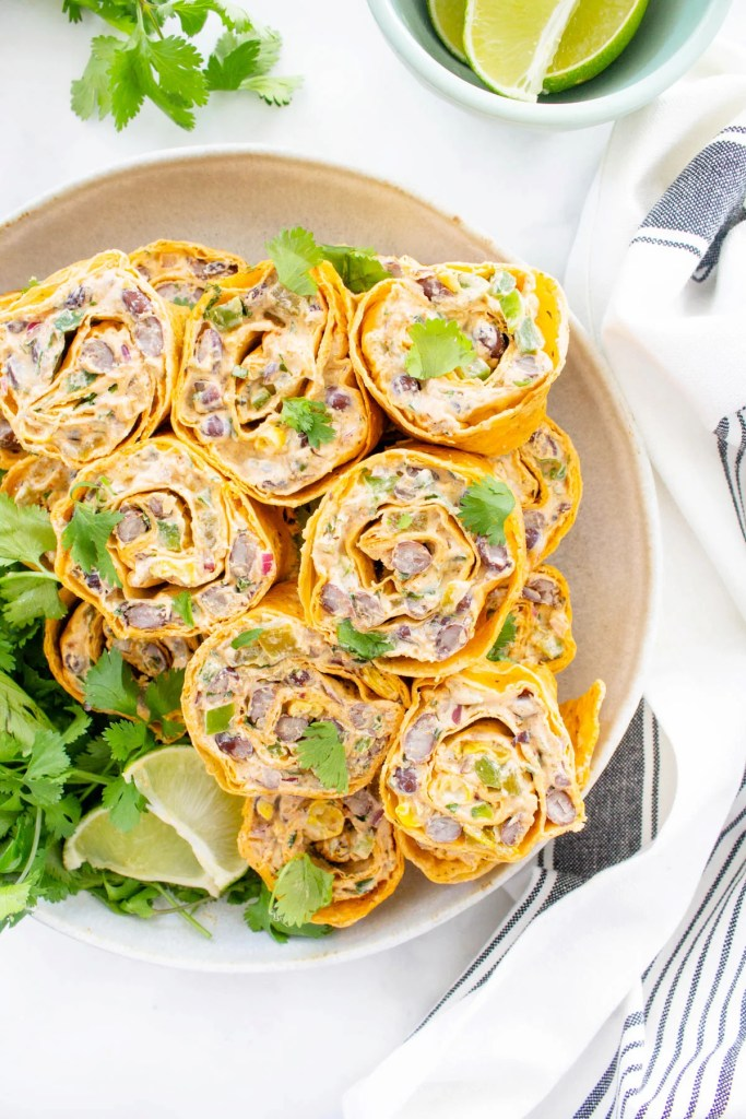 These Simple Vegan Taco Pinwheels are the perfect party appetizer, make ahead lunch or easy snack. No need to cook when you can eat a pinwheel instead   ThisSavoryVegan.com #thissavoryvegan #veganwrap #veganpinwheels