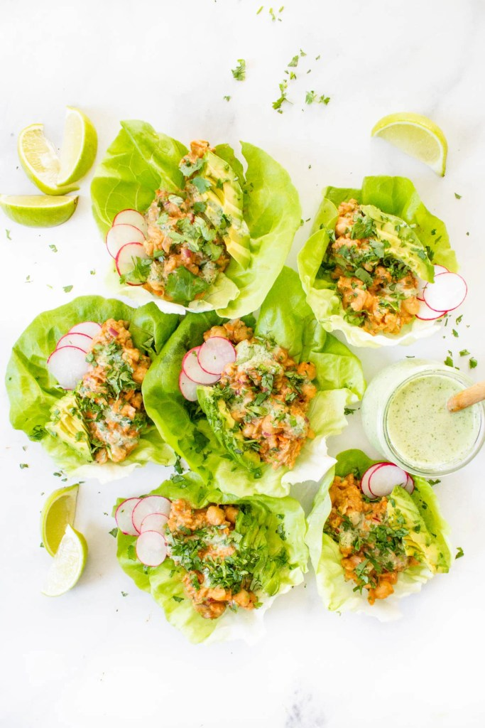 These BBQ Chickpea Lettuce Wraps are the perfect lunch or dinner when you don't feel like cooking. Topped with Vegan Cilantro Ranch Dressing & avocado slices   ThisSavoryVegan.com #thissavoryvegan #bbqchickpeas #veganlettucewraps