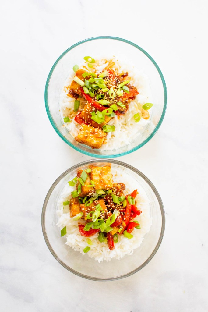 These Vegan Kung Pao Tofu Bowls are a better than takeout vegan dinner at home. Filled with sticky, savory & sweet tofu, red bell pepper & rice | ThisSavoryVegan.com #thissavoryvegan #kungpao #tofurecipes