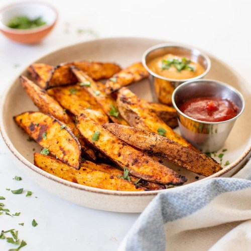 These Air Fryer Potato Wedges are perfectly crunchy, smoky and garlicky. Serve them with your favorite dipping sauce for a snack or side dish | ThisSavoryVegan.com #thissavoryvegan #airfryerrecipe #potatowedges