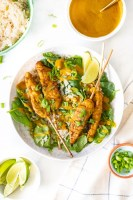 These Vegan Chicken Satay Bowls are loaded with coconut rice, spinach, air fryer vegan chicken satay skewers and a curry peanut sauce! Comforting and quick dinner idea | ThisSavoryVegan.com #thissavoryvegan #veganchickensatay #peanutsauce