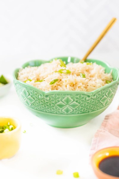 This Simple Vegan Coconut Rice is decadent, buttery and the perfect addition to any meal. You won't want to eat rice any other way after you try this | ThisSavoryVegan.com #thissavoryvegan #coconutrice #vegansidedish