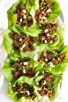 These Vegan Beef Lettuce Wraps are the perfect light meal. Loaded with vegan beef crumbles, a hoisin sauce and crunchy water chestnuts   ThisSavoryVegan.com #thissavoryvegan #veganappetizer #lettucewraps