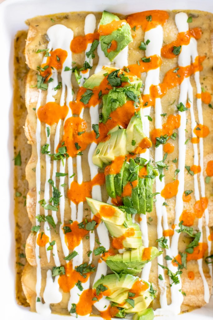 These Roasted Poblano Vegan Enchiladas are creamy, veggie-packed and super simple. A great make ahead vegan dinner | ThisSavoryVegan.com #thissavoryvegan #veganenchiladas #vegancasserole