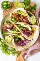 The perfect savory breakfast - these Vegan Potato & Egg Breakfast Tacos have veggies, soyrizo, scrambled vegan eggs and plenty of toppings   ThisSavoryVegan.com #thissavoryvegan #vegantacos #breakfasttacos
