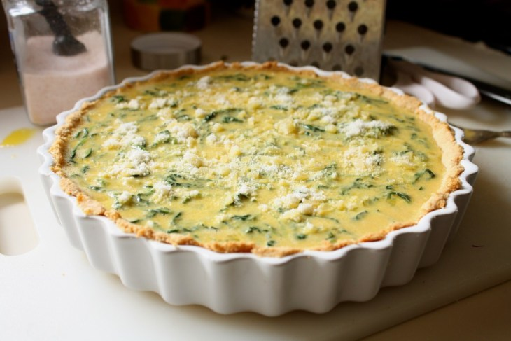 gluten free spinach quiche uncooked on counter