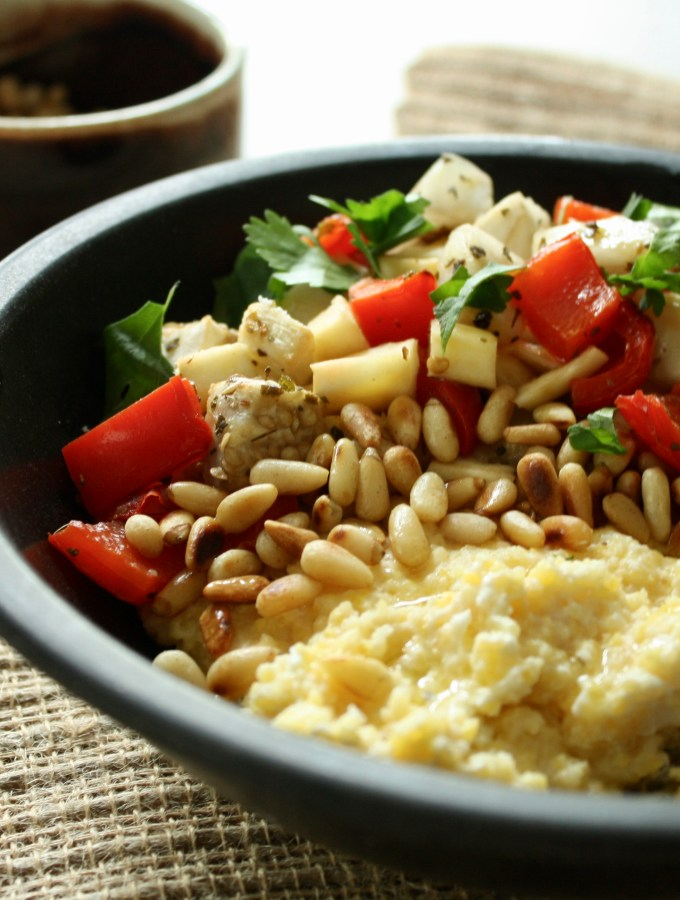 Mediterranean polenta bowl with goat cheese and roasted pine nuts