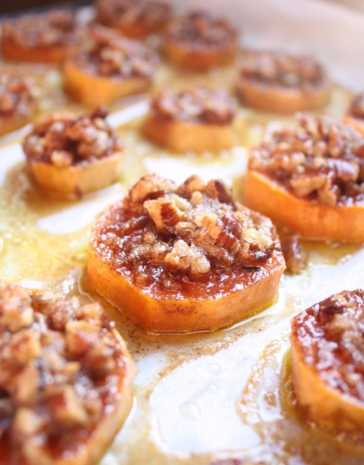 Sweet potato bites on a tray topped with pecan praline topping