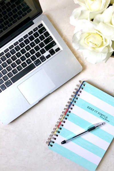 picture of laptop, flowers and notebook
