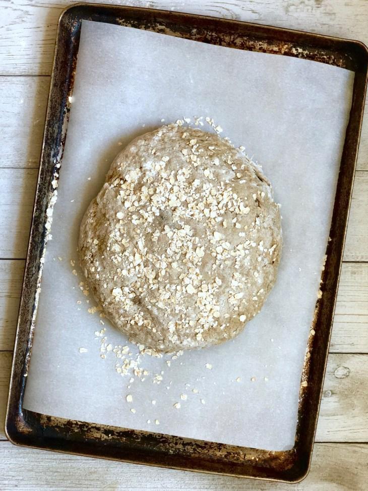 brown bread dough shaped in a disc