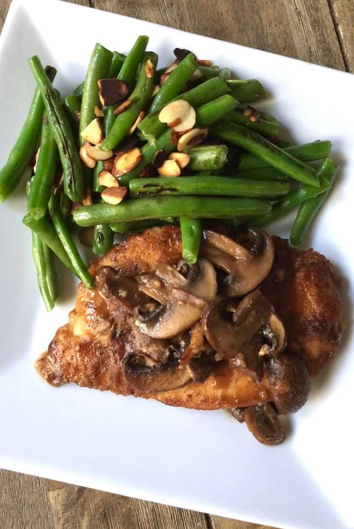 chicken marsala and green beans on a plate
