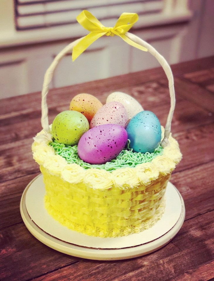 cake that looks like an easter basket and topped with eggs