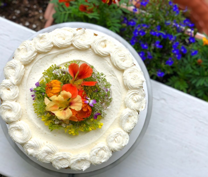 carrot cake with edible flowers