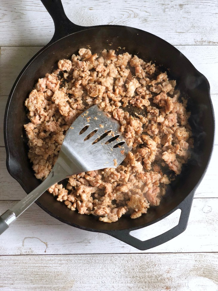 cooked chicken sausage in a skillet