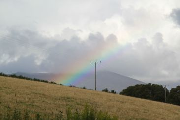 Ben Rinnes with a rainbow