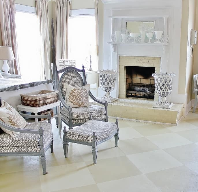 Flooring Fixes Painted Floors in White and Neutral Master Bedroom with Fireplace and Gray Accessories