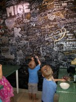 Signing the wall at Footprints Hostel. From the Wood's trip to Singapore in 2014