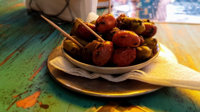 Delicious olives in harisa paste