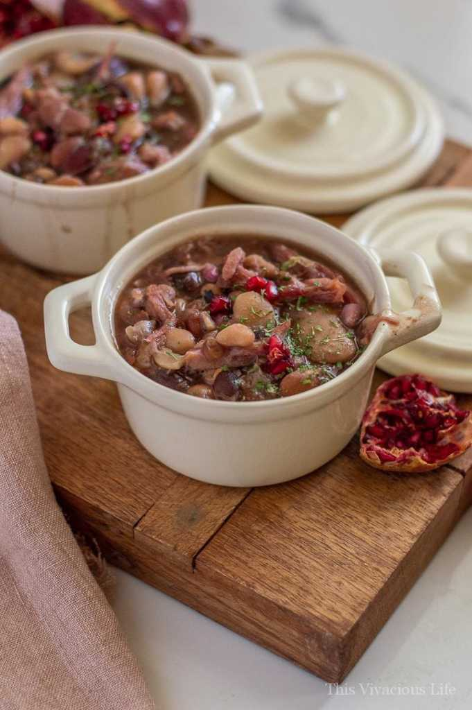 This slow cooker ham and bean soup is so warm and filling. The fresh pomegranate adds so much freshness! While you can let it sit and cook all day in the slow cooker, you can also whip it up even quicker in your Instant Pot. Either way, it is sure to fill hungry bellies during those cold winter months. I love the this soup is great for using your leftover Thanksgiving ham! || This Vivacious Life #slowcooker #souprecipe #ham #thisvivaciouslife