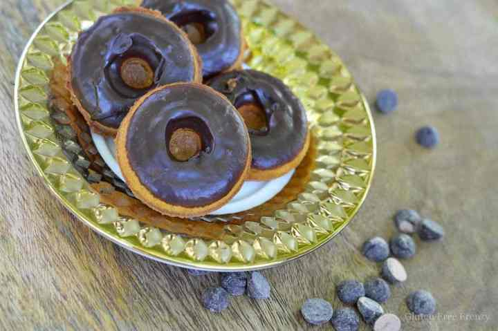 How delicious are these chocolate dipped pumpkin spice donuts?! SO yummy and easy to make! They are also gluten-free, dairy-free and so delicious that anybody will love them. Serve these tasty treats at your next Halloween party for a great dessert. glutenfreefrenzy.com