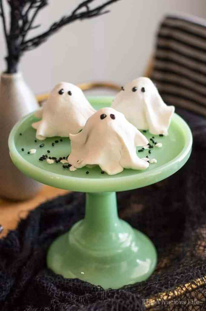 No-bake ghost cookies on a jadeite cake stand