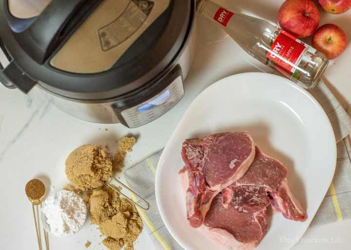 Instant Pot and ingredients for pork chops with cinnamon apples