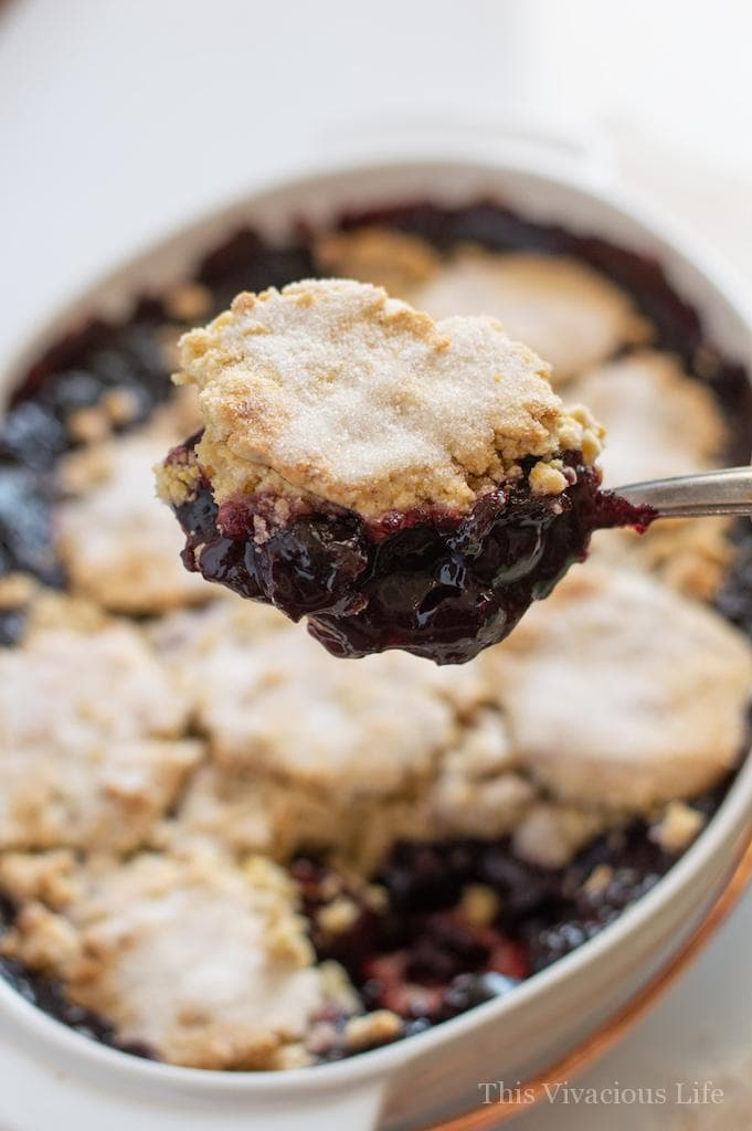 This gluten-free cherry cobbler is sure to please any palate. It is a crowd pleasing dessert and perfect for a summer picnic or bbq. || This Vivacious Life #recipe #glutenfree #gf #cherrycobbler #cobbler #glutenfreedessert #summerdessert