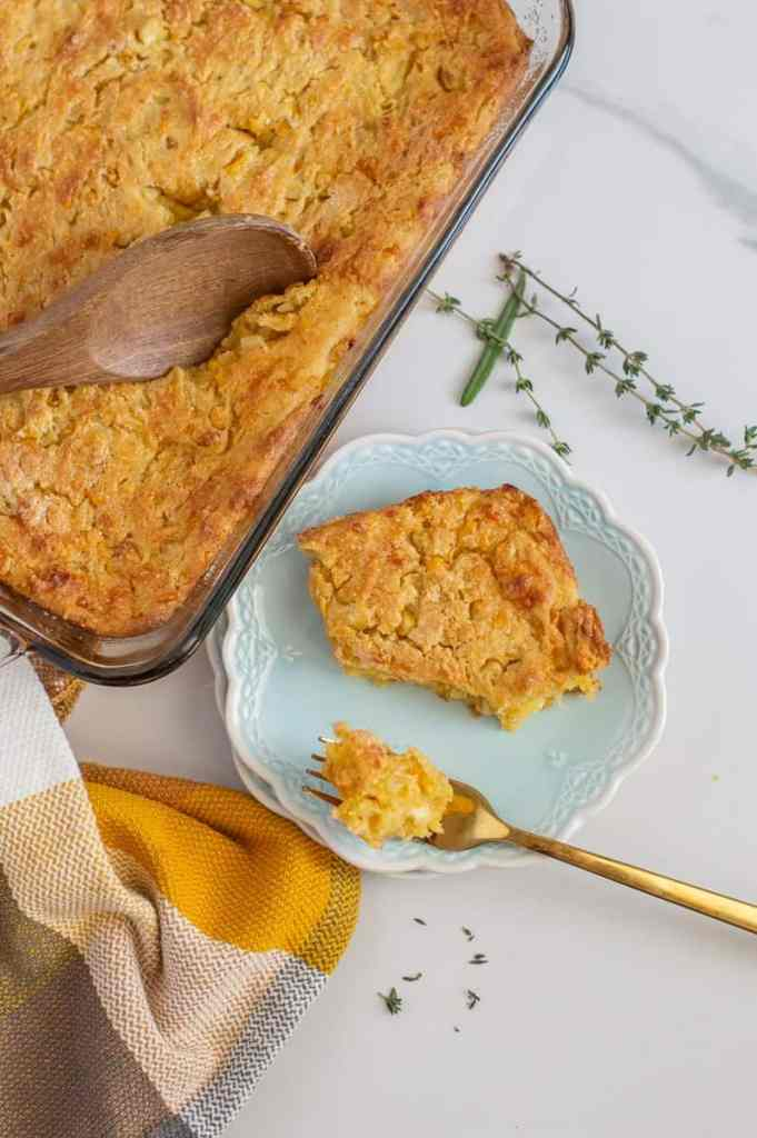 Overhead shot of gluten-free cornbread casserole in pan and on a plate